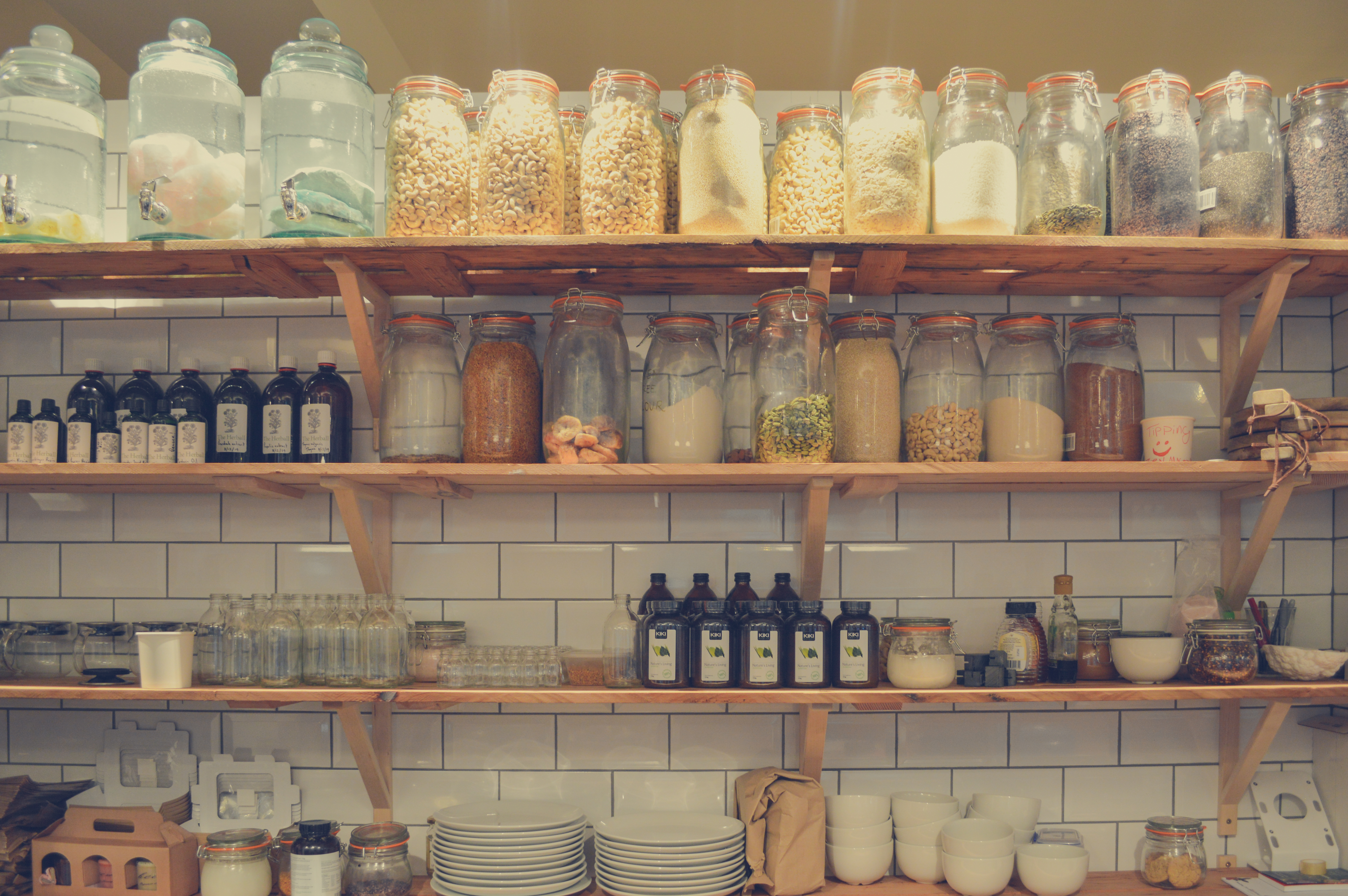 An image of open shelving in a kitchen, with objects sealed and stored high above a child's reach