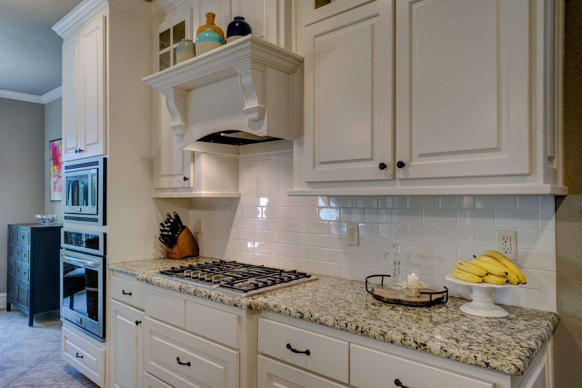 A bright white kitchen, with freshly repainted cabinets